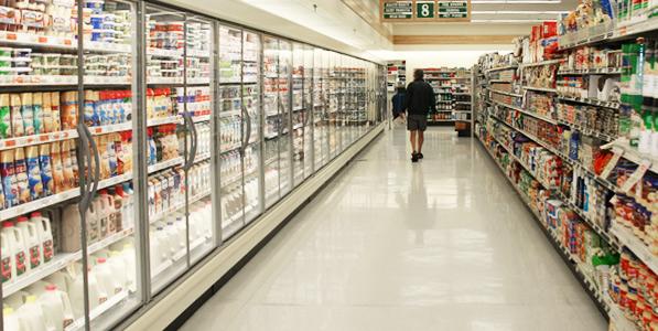 customer walking down food aisle